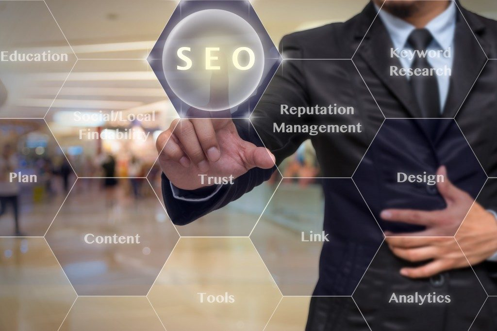 businessman pointing at SEO concept