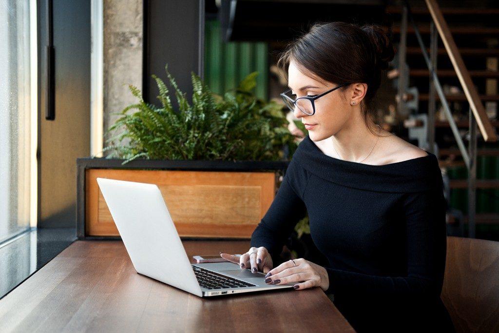 Woman browsing through the internet