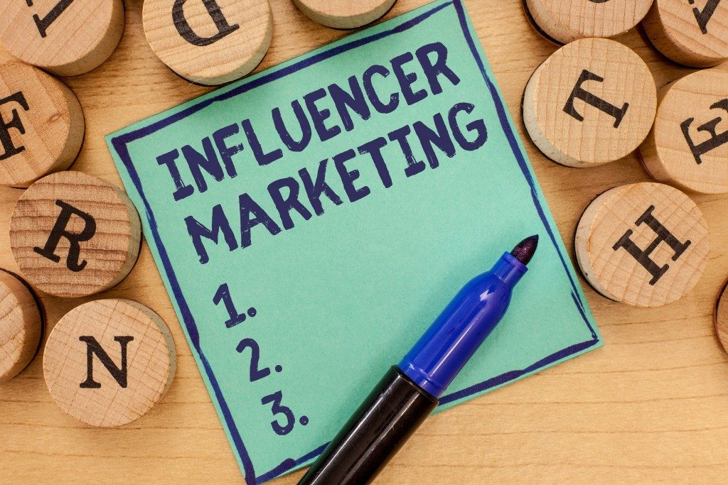 Handwriting text Influencer Marketing